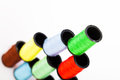 Pyramid of colourful cotton reels viewed from above at an oblique angle with focus to the top green bobbin Royalty Free Stock Photography