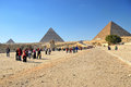 Pyramid in giza feb egyptian people under the egypt on feb the world s oldest tourist attraction the pyramids of are Royalty Free Stock Images