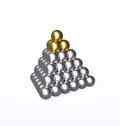 Pyramid with gold and silver balls isolated metallic golden on top of the larger one mountain of metal are tightly packed Royalty Free Stock Image