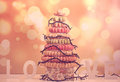 Pyramid of macaroons with Christmas lights Royalty Free Stock Photo