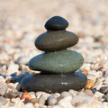 Pyramid made with wet pebble stones Royalty Free Stock Image