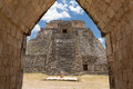 The pyramid of the magician uxmal yucatan mexico seen from under an ancient arch in Stock Images
