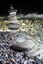 Pyramid from pebble on seacoast at night Stock Photography