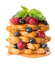 Pyramid of puff pastry with berries on white Royalty Free Stock Images