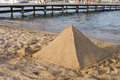 Pyramid Shaped Sand Castle Stock Photo