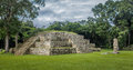 Pyramid and Stella in Great Plaza of Mayan Ruins - Copan Archaeological Site, Honduras Royalty Free Stock Photo