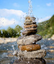 Pyramid of stones beside a mountain river Stock Photography