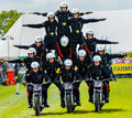 Pyramid stunt motorbike riders the white helmets are a group of specially trained british army who perform at shows throughout the Royalty Free Stock Photography