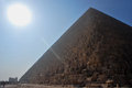 Pyramid with sunbeam many stone in egypt blue sky and Stock Photo