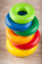 Pyramid of toy plastic colorful rings on table Royalty Free Stock Photo