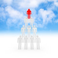 Pyramid of white abstract d people with one red leader on top with blue sky on a background Stock Photography