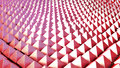 Pyramidatron background of red pyramidal structures fill the entire frame Royalty Free Stock Images