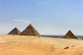 Pyramids in egypt with the city of cairo in the background a photograph giza Stock Images