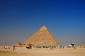 Pyramids in egypt with tourists blue sky and many on vacation Royalty Free Stock Photos