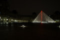 Pyramids and fountain of Louvre Museum in the night