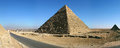 Pyramids of giza in cairo panorama view with a blue sky Stock Images