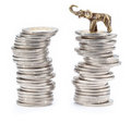Pyramids made with coins and lucky elephant Stock Photo