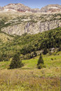 Pyrennes mountains benasque with trees situated in the spanish province of huesca it s a sunny day in it s a vertical Stock Photo
