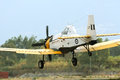 PZL M18 B Dromader airplane in low terrain flight Stock Photography