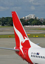 Qantas plane tail logo at sydney international airport australia february Stock Image
