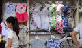 Qipao dresses for sale chinese people in front of a street vendor selling or traditional chinese Royalty Free Stock Photos
