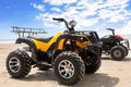 Quad bike on sand Royalty Free Stock Photo