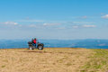 Quad biking in the mountains equipped atv driver and passenger landscape spring Stock Photography
