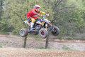 Quad racer in red is jumping Royalty Free Stock Photo