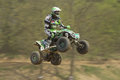 Quad racerin green is jumping Royalty Free Stock Photo