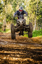 Quad rider jumping on a forest trail Stock Photos