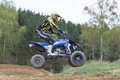 Quad rider is jumping in the race Royalty Free Stock Photo