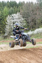 Quad rider is jumping in the spring nature Royalty Free Stock Photo