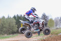 Quad rider is tilted in jumping Royalty Free Stock Photo