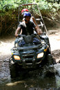 Quadbike splashing water Royalty Free Stock Photo
