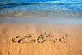 Quadratic equation handwriting on the sand. Royalty Free Stock Photo
