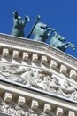 Quadriga of horses on the roof of bolshoy theater building in moscow blue sky background Royalty Free Stock Photo