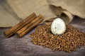 Quail egg with buckwheat on wood background Stock Photography
