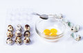 Quail eggs, bowl, broken eggs Royalty Free Stock Photo