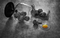 Quail eggs on the table. Broken quail egg. Black and white still life with quail eggs. Royalty Free Stock Photo