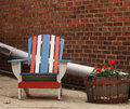 Quaint Americana Chair in alley with brick building Royalty Free Stock Photo