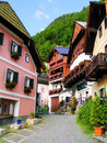 Quaint austrian street lined with traditional wooden houses in hallstatt austria Royalty Free Stock Images
