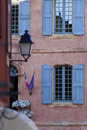 Quaint building blue window shutters exterior of a with windows and wooden Royalty Free Stock Image
