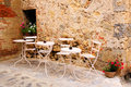 Quaint cafe tables and chairs outside in a corner of tuscany italy Royalty Free Stock Image