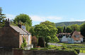 Quaint english village scenic view of homes in summer scene Stock Photo