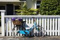 Quaint living beach side a beach cottage white fence small garden bicycle in front Royalty Free Stock Photography