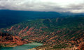 Quake lake landform ancient old red green mountain hill blue Stock Photo