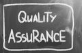Quality assurance concept handwritten with chalk on a blackboard Royalty Free Stock Photo