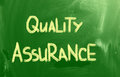 Quality assurance concept handwritten with chalk on a blackboard Royalty Free Stock Images