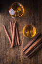 Quality cigars and cognac on an old wooden table Stock Image