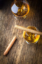 Quality cigars and cognac on an old wooden table Royalty Free Stock Image
